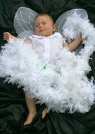 toddler in an angel costume with wings