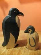 mother penguin and her baby is made of wood