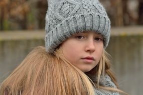 Long hair blond Girl in grey hat