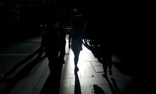 Silhouettes of people on a walk at night