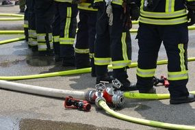fire extinguishing firefighters in protective clothing