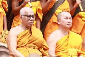 Buddhists in orange robes