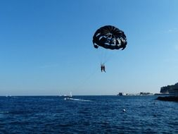 skydiver over blue water