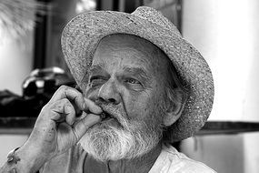 old man portrait cigar beard hat white and black color photo