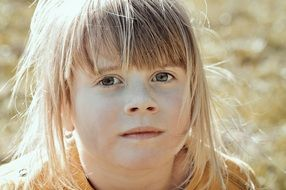 blond girl child face portrait