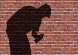 shadow of a man on a brick wall background