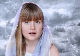 girl face on the background of clouds and rain