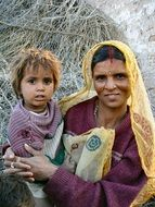 mother is holding a baby in India