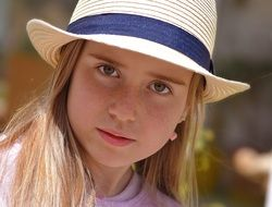 young girl in the hat view