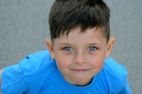 portrait of the blue-eyed boy in a blue T-shirt