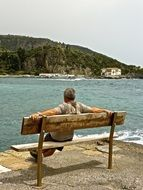 man on the bench, contemplate the beauty of water