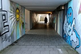 dark underpass tunnel with human person
