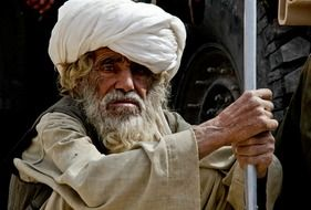 old man in traditional clothes in afghanistan