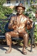 bollywood actor kapoor raj sits on bench, bronze sculpture, india, mumbai
