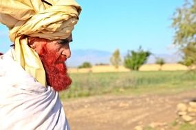 old man with turban and red beard