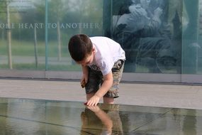 boy at the memorial