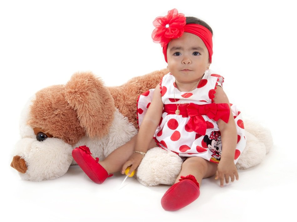 Little girl with a big plush toy