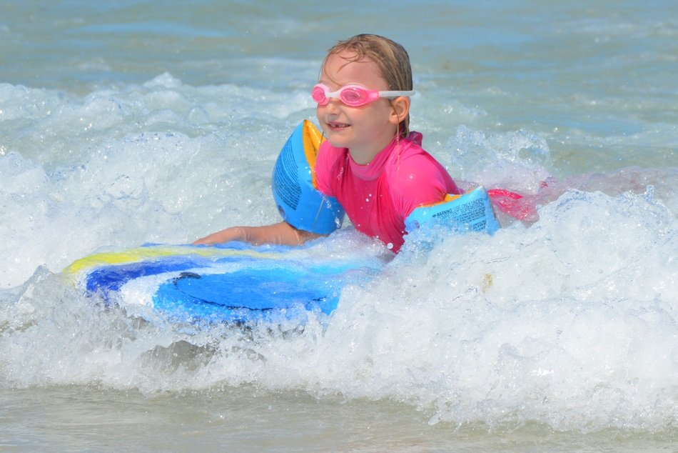 Little girl on the waves