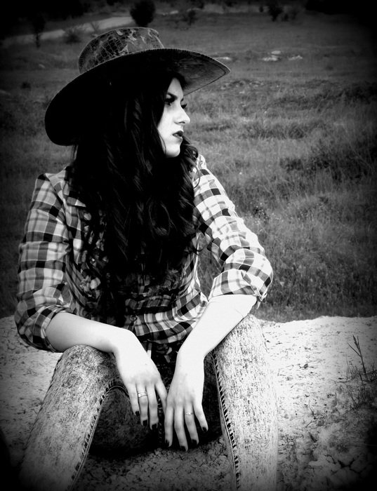 Black and white image of a girl in the style of the wild west