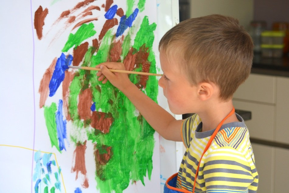 boy child painting brush