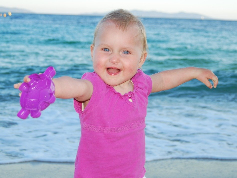 extraordinarily beautiful child on sea girl french riviera
