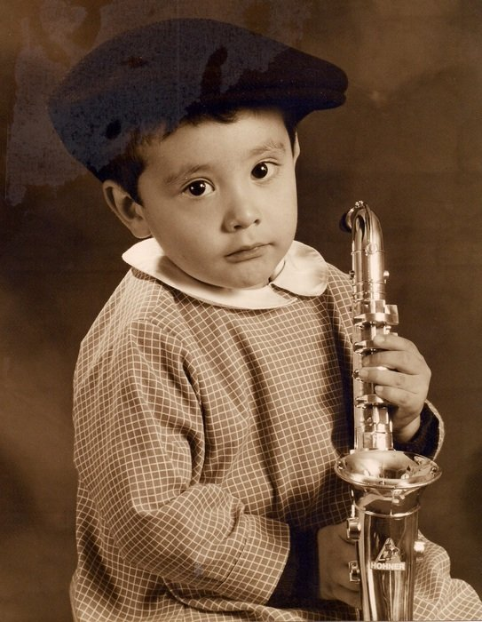Black and white image of a little boy with saxophone