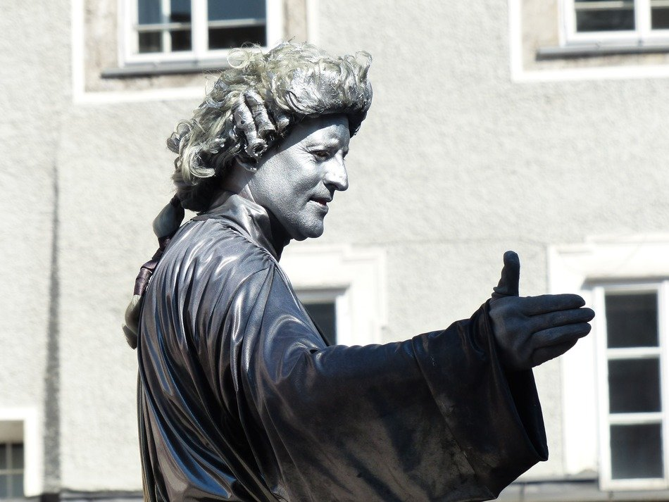 street artists pantomime mozart statue