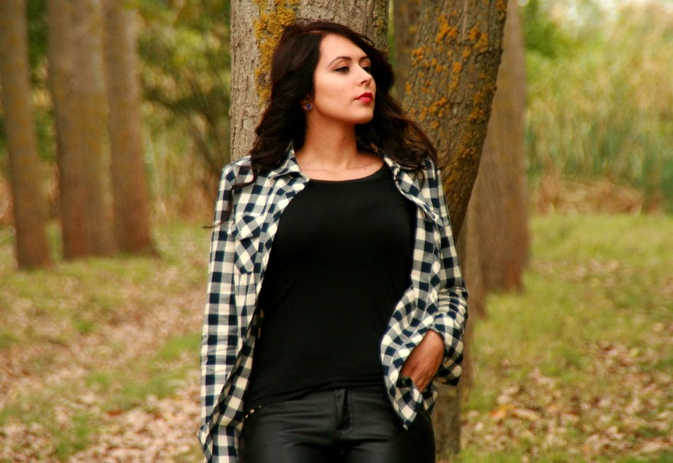 Beautiful brunette by the tree