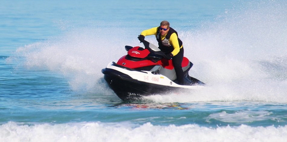 A man on a hydrocycle on a wave