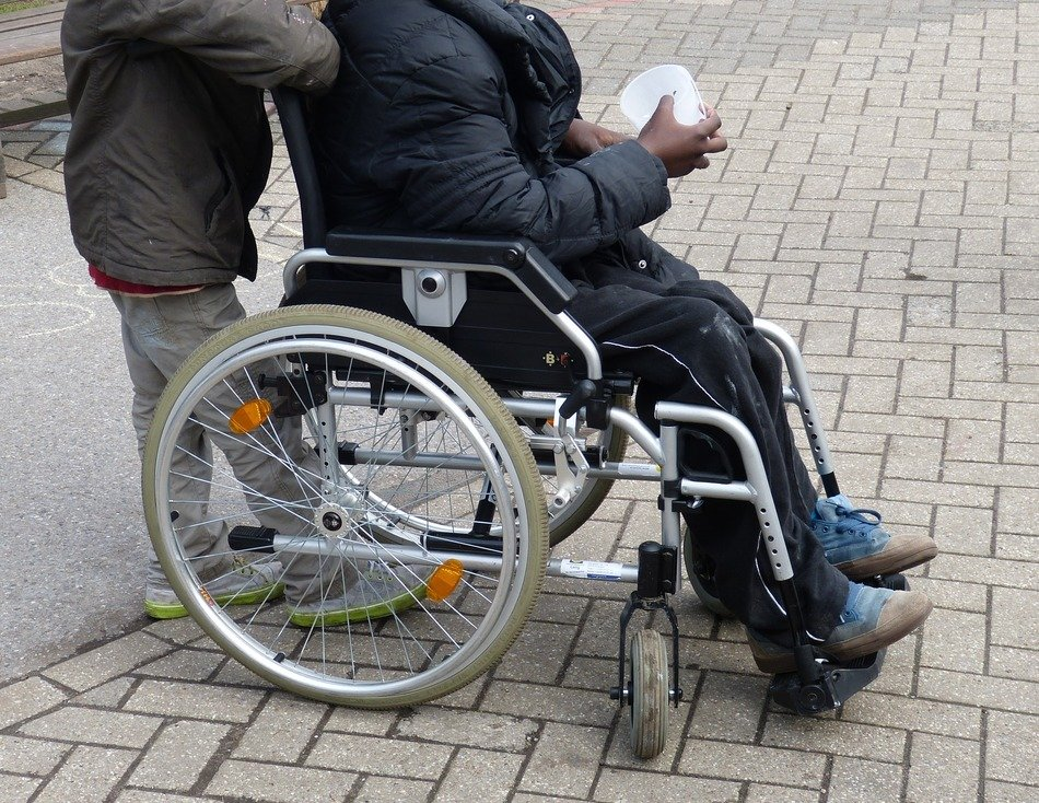Person on the wheelchair on the pavement