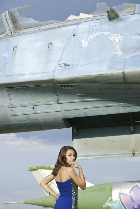 Girl in blue dress near the airplane