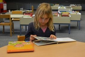 child girl people library books