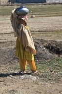 afghan girl carrying water