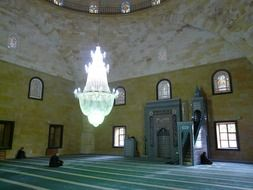 Big chandelier in the prayer hall in the mosque