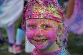 stained paint the girl's face at the festival