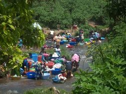 african women washing laundry in river