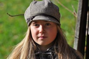 child girl face long hair blond hat