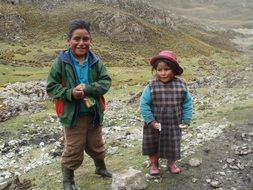 two tribal kids at road, peru