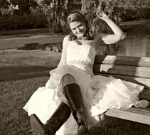 girl in a wedding dress on a bench