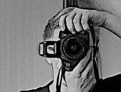 black and white drawing of a man with a camera in the form of a self-portrait of the photographer