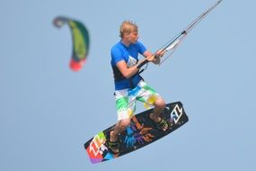 Man is engaged in kite surfing