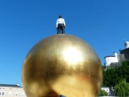 man on a gold ball in Salzburg