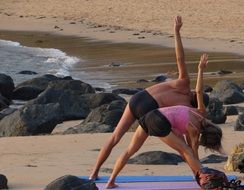 a man and a woman do the exercise on the west coast of India, Gokarna, Karnataka