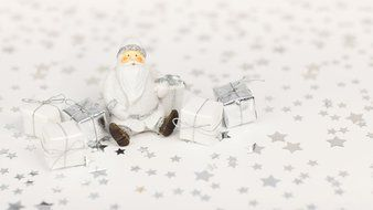 santa claus sitting among gift boxes, christmas decoration