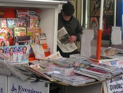 sale of magazines and newspapers at a kiosk