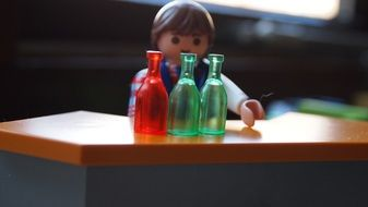 playmobil man and bottles toy