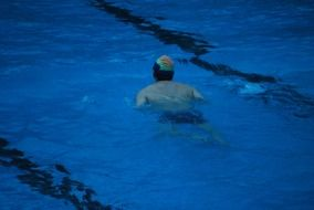 swimmer in the blue pool
