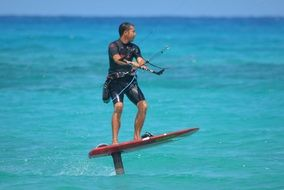 man engaged kite surfing