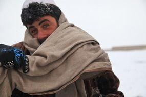afghani man in cold winter portrait
