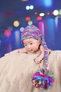baby in a multicolored cap